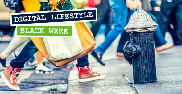 Symbolbild für den Black Friday bzw. die Black Week mit Menschen mit Einkaufstüten.