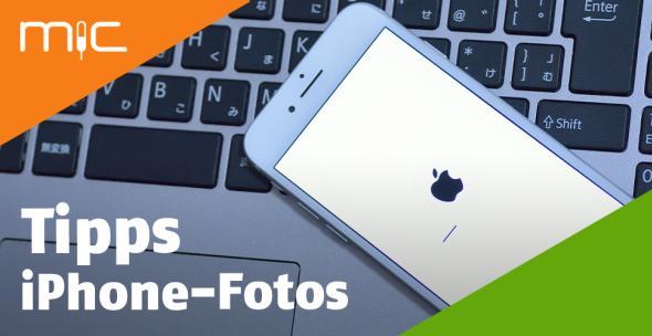 Ein iPhone liegt auf einem Macbook.