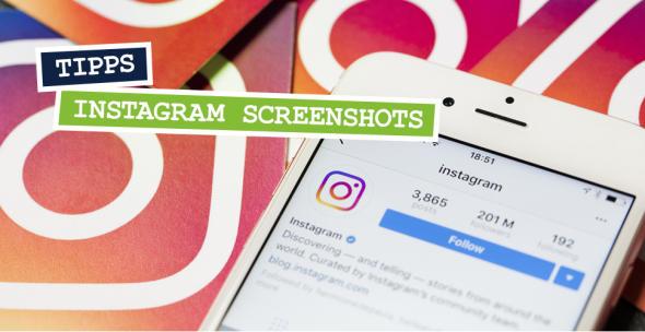 Smartphone mit geöffneter Instagram-App auf Instagram-Symbolen liegend.