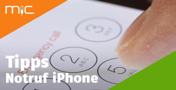 Auf dem Bildschirm eines Smartphones tippt jemand die Notrufnummer.